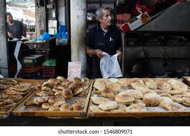 ISRAEL, JERUSALEM 12 October 2019: bread sellers on the Mach ane Yehuda Market, fresh market in Jerusalem with fresh vegetables, fruits, bread and various products