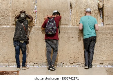 ISRAEL. JERUSALEM. 12.05.2018 - Three religious jews pray in The western wall , An Important Jewish religious site located in the Old City of Jerusalem