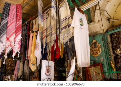 Israel, Jerusalem - 13 April 2019:  traditional Israeli fabrics on bazaar, clothes, scarves - souvenir from Israel