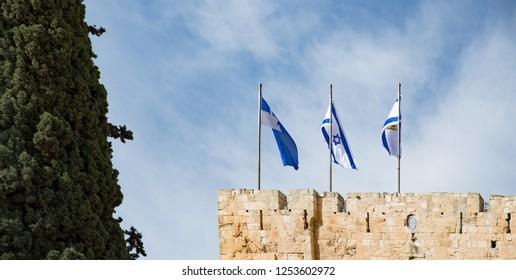 Israel and Jerusalem flags on Jerusalem old city walls