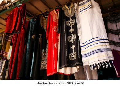 Israel, Jerusalem, Mach ane Yehuda Market: traditional Israeli fabrics on bazaar, clothes, scarves, souvenir from Israel