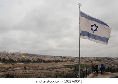 Israel, Jerusalem. The national flag of Israel at Mount of Olives, old town of Jerusalem at a rear. Hexagram in the center is Ma Hen David, known as the Shield of David, or Star of David.