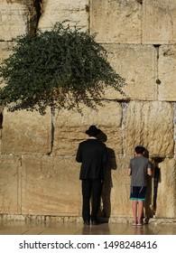 Israel Jerusalem Western Wall father and son praying