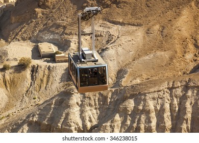 ISRAEL, MASADA - OCTOBER 27, 2014: Cable car to ruins of Masada ancient fortress - one of the most visited place in places in country.