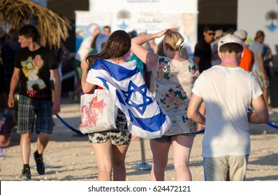 ISRAEL. NEGEV DESERT - SEPTEMBER 12, 2014: Young girls decorated with an Israeli flag