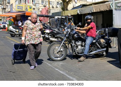 ISRAEL - Netanya, 13 October 2017: a man on a motorcycle drives out from the parking of the city market