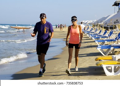 ISRAEL - Netanya, 14 October 2017: man and woman walking together on the beach of the Mediterranean