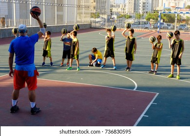 ISRAEL - Netanya, 16 October 2017: children's basketball training on the street children's basketball team under the guidance of the coach
