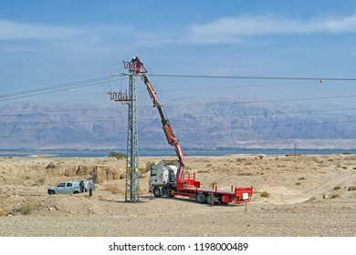 ISRAEL - OCTOBER 7, 2018: Electricians works on maintenance of high-voltage electric power line near the Dead Sea coast in Israel.