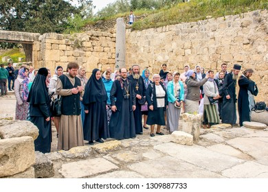 Israel / Samaria - 03.27.2016: Herod the Great Palace in Sebastia. Orthodox Christians praying in the ruined temple of the beheading of John the Baptist