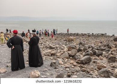 ISRAEL, shores of the Sea of Galilee October 11, 2018: Priests and tourists on the shores of the Sea of Galilee .