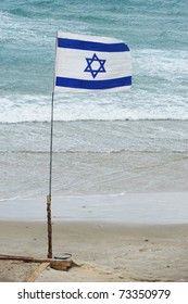 Israel state flag on a beach in Tel Aviv