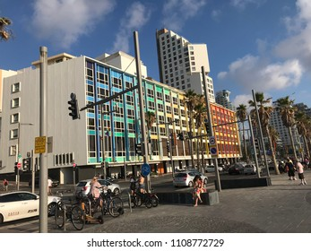 Israel, Tel Aviv - June 7, 2018: View from the beach promenade of Tel Aviv. Different styles in buildings and people walking around, swimming and resting in the evening.