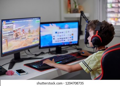 Israel Tel Aviv October 15, 2018: Teenager playing Fortnite video game on PC. Fortnite is an online multiplayer video game developed by Epic Games.
