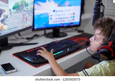 Israel Tel Aviv October 15, 2018: Teenager playing Fortnite video game on PC. Fortnite is an online multiplayer video game developed by Epic Games