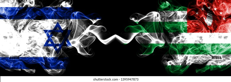 Israel vs Abkhazia, Abkhazian smoky mystic flags placed side by side. Thick colored silky smokes flag of Israel and Abkhazia, Abkhazian.