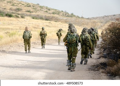 Israeli combat soldiers of counter-terror squad return on a gravel path with first daylight after a successful night raid in South of Lebanon during the Second Lebanon military campaign / war.