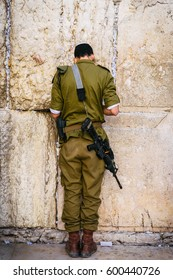 An Israeli Defence Force (IDF) soldier prays at the Western (Wailing) Wall in Jerusalem, Israel