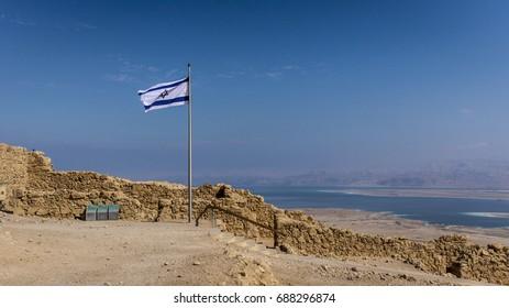 Israeli flag on top of Masada, overlooking the Dead Sea in Southern Jerusalem.