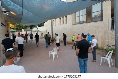 Israeli Jewish religious pray beside their synagogue  separated to insure social distancing spread of the novel coronavirus in Modiin Israel July 9,2020.
