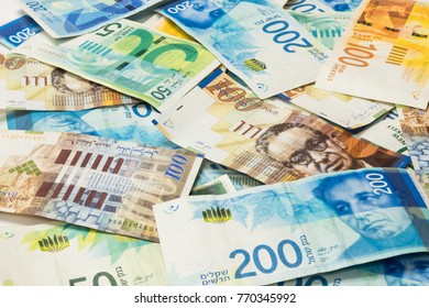 Israeli money stack of new Israeli banknotes of different value in shekels (NIS)