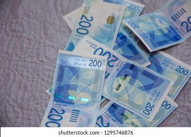 Israeli money stack of the new Israeli money bills (banknotes) of 200 and 50 shekel. New Israeli Shekel series C.