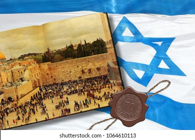 Israeli National flag with Magen David star. Old book with image of Western or Wailing Wall of Jerusalem. Wax seal dedicated to 70 anniversary Israel state formation (1948 - 2018). Independence Day