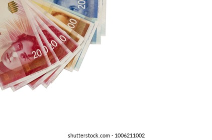 Israeli New Sheqel banknotes and coins on Grey background.Copy Space
