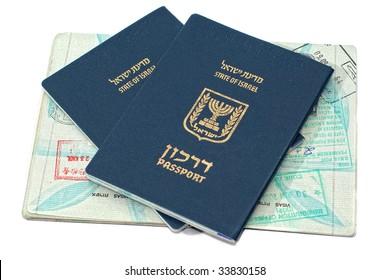 Israeli passports passport sitting on an open passport with passport stamps