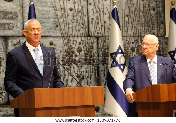 Israeli President Reuven Rivlin (R) presents Blue and White party leader Benny Gantz with the mandate to form a new Israeli government at the President's residence in Jerusalem, on Oct. 23, 2019.