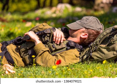 An Israeli soldier resting on the Golan Heights