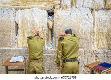 Israeli soldiers praying in the Western Wall