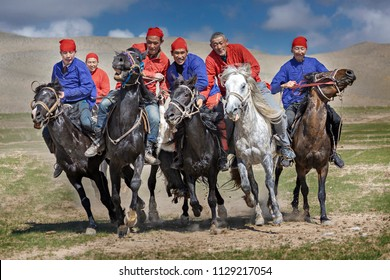 ISSYK KUL, KYRGYZSTAN - JUNE 5, 2018: Nomad horse riders play traditional horse game of Buzkashi known also as Kokpar, in Issyk Kul, Kyrgyzstan.