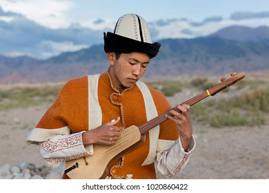 ISSYK KUL, KYRGYZSTAN - MAY 28, 2017: Musician plays local traditional instruments, in Issyk Kul, Kyrgyzstan.