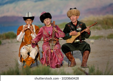 ISSYK KUL, KYRGYZSTAN - MAY 28, 2017: Musicians play local traditional instruments, in Issyk Kul, Kyrgyzstan.
