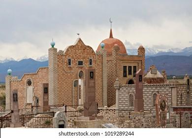 ISSYK KUL, KYRGYZSTAN - MAY 30, 2017: Central asian muslim cemetery near the Issyk Kul Lake, in Kyrgyzstan.
