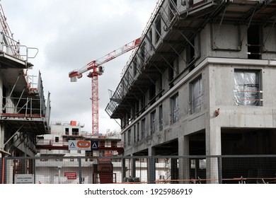 Issy-les moulineaux, France - 02 17 2021: Cranes rise into the sky on a construction site for an office and housing building for the Bouygues Group in the southern suburbs of Paris