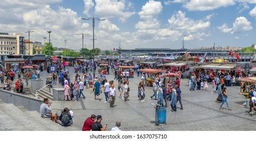 Istambul, Turkey – 07.13.2019. Many people on the Eminonu Embankment near the Galata bridge in Istanbul, on a sunny summer day
