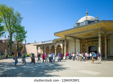 Istambul , Turkey - Mai 1, 2013:  Topkapi Palace,  second courtyard,  viditors near the Gate of Felicity