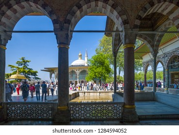 Istambul , Turkey - Mai 1, 2013:  Topkapi Palace,  fourth courtyard, viisitors on the upper terrace seen from the Yerevan kiosk