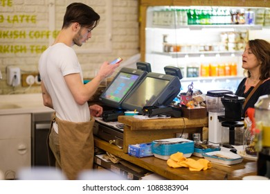 Istanbul, 01 may 2018: Cash desks with cashier serves customer in small cafe, Turkey