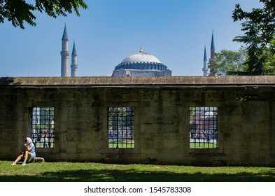 Istanbul, 06/26/2019: Hagia Sophia, former Greek Orthodox Christian patriarchal cathedral, later Ottoman imperial mosque and now a museum, through the courtyard of Sultan Ahmed Mosque or Blue Mosque