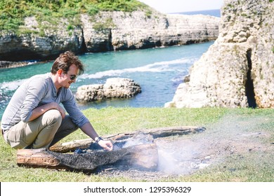 Istanbul 2018: A man sitting near the campfire and enjoying on a sunny day. Kilimli Cove in Agva istanbul.