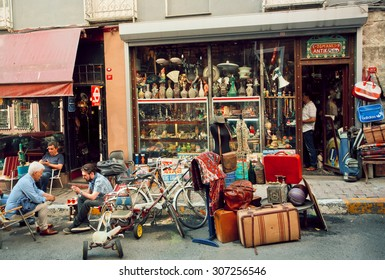 ISTANBUL - 23 JULY: Antique market and people drinking tea near vintage furniture store on July 23, 2015 in Cukurcuma district. Istanbul is the world's fifth-most-popular tourist destination
