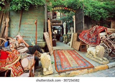 ISTANBUL - 23 JULY: Flea market with antique furniture and asian carpets on the street with vintage shops on July 23, 2015 in Cukurcuma. Istanbul is the world's fifth-most-popular tourist destination