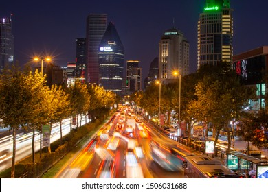 ISTANBUL, 4. LEVENT DISTRICT, TURKEY - SEPTEMBER 14, 2019: Road Traffic during the evening and night. Road intersection with traffic light. Traffic jam with skyscrapers and modern office on background