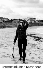 Istanbul, Agva / Turkey - 11.03.2018: A young woman walking and enjoying beach alone on autumn. Black and white photography.
