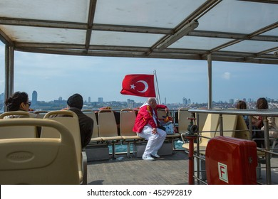 ISTANBUL - APR 22: Turkish flag at the stern boat-ferry and passengers. Bosphorus. Istanbul, Turkey. April 22, 2013.