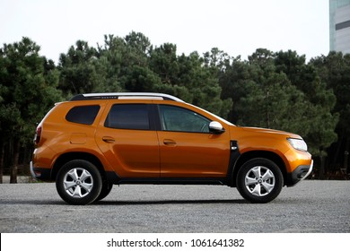 ISTANBUL - APRIL 02, 2018:Orange Duster, Dacia's SUV model. Comfortable, off-road, affordable car that combines technology.