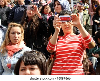 ISTANBUL - APRIL 23: Unidentified music fans records the show during Bengu Erden Concert at Marmara Egitim Kurumlari on April 23, 2011 in Istanbul, Turkey.